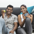 Happy young Indian couple relaxing at home — Stock Photo