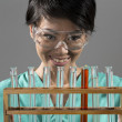 Female scientist looking at a row of test tubes — Stock Photo