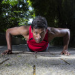 Indian man performing push up in the city park. — Stock Photo