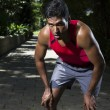 Athletic Indian man having a break from running — Stock Photo