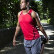Athletic Indian man warming up and stretching before exercising — Stock Photo