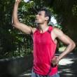 Indian man having a break from running — Stock Photo