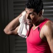 Athletic Indian man resting after exercise. — Stock Photo