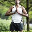 Indian man doing yoga exercise in park — Stock Photo #27027849