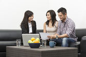 Finance Consultant showing investment plans to Asian couple — Stock Photo