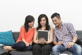Chinese friends hanging out together using Digital Tablet — Stock Photo
