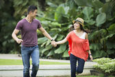 Young Chinese Couple having fun in park — Stock Photo