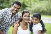 Happy Indian family at the park. — Foto de Stock