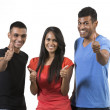 Stock Photo: Happy group of Indian friends with thumbs up.