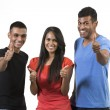 Happy group of Indian friends with thumbs up. — Stock Photo