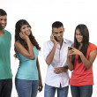 Stock Photo: Group of young Indifriends using their smartphones.