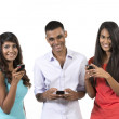 Group of young Indian friends using their smartphones. — Stock Photo #36759715