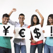 Indian people holding banners with currency symbols — Stock Photo
