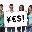 Indian people holding banners with currency symbols — Stock Photo #36759811