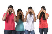 Four Indian people with their hands over their eyes. — Stock Photo