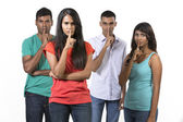 Group of Indian friends with fingers over lips. — Foto Stock