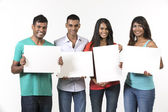 Group of Indian people with a banner ad. — Stock Photo