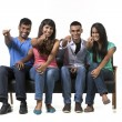 Happy group of Indian friends pointing.  — Stock Photo