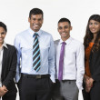 Team of four happy Indian business people. — Stok fotoğraf