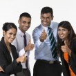 Team of happy Indian business people with Thumbs Up — Stock Photo