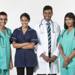 Indian medical team standing on white background — Stock Photo #36761335