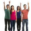 Group of happy Chinese friends pointing upwards. — Stock Photo