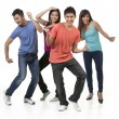 Happy group of Chinese friends dancing.  — Stock Photo