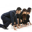 Chinese business team ready to start a race. — Stock Photo