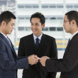 Two business men exchanging business cards — Stock Photo #36768289