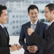 Stock Photo: Two business men exchanging business cards