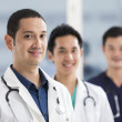 Team of male doctors and medical support staff — Stock Photo