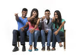 Happy group of Indian friends pointing. — Foto Stock