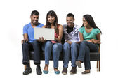 Group of Indian friends using modern technology. — Stock Photo