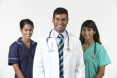Indian medical team standing on white background — Stock Photo