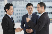 Two business men exchanging business cards — Stock Photo