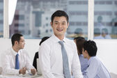 Happy Asian Business man with his team — Stock Photo