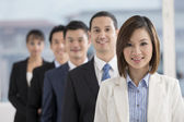 Asian Businesswoman leading a business team — Stock Photo