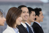 Happy Business man with his multi-ethnic team — Stock Photo