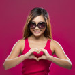 Chinese Woman making heart symbol with her hands. — Stock Photo #36806749