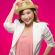 Stock Photo: Fashionable Asian Woman wearing straw hat.