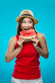 Happy Chinese Woman holding fruit on colorful background. — Stock Photo