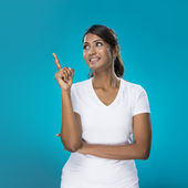 Portrait of happy Indian Woman pointing at something. — Stock Photo