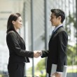 Chinese Business people shaking hands — Stock Photo #36810031