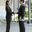 Chinese Business people shaking hands — Foto Stock