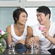 Happy Asian man giving a present to his girlfriend — Stock Photo
