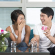 Happy Asian man giving a present to his girlfriend — Stock Photo #36810377