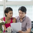 Serious Asian couple reading a financial bill — Stock Photo #36810575