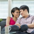 Happy Chinese couple at home together — Stock Photo #36810629