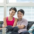 Happy Chinese couple at home together — Stock Photo