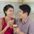 Happy Asian couple together at home — Lizenzfreies Foto
